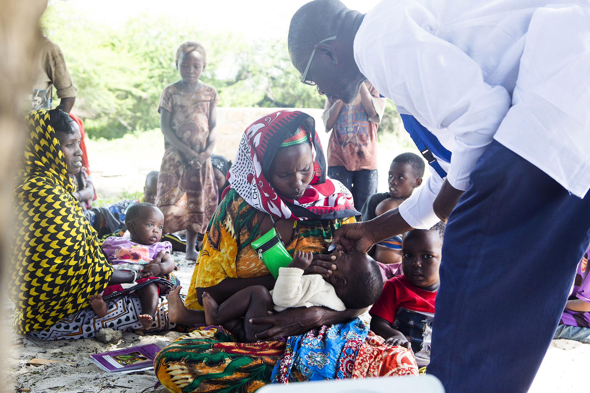 Nurse-Kalu-Harrison-gives-vaccine-to-a-baby-in-Kiangwe-village